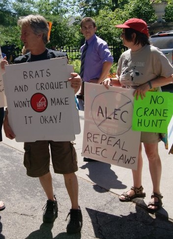 """Brats and croquet won't make it ok"" and ""Repeal ALEC laws"" (source: Leslie Peterson)"