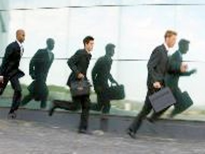 Businessmen running