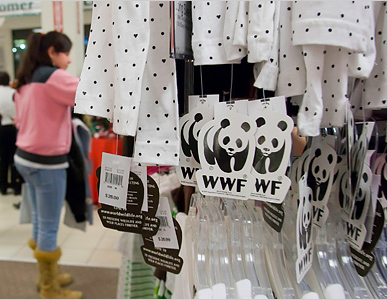 Tags on clothing for sale at J.C. Penney that promise a donation to WWF.