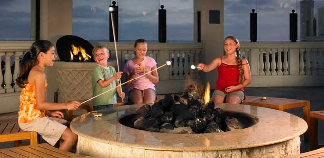 Kids roasting marshmallows at the Manchester Grand Hyatt, San Diego