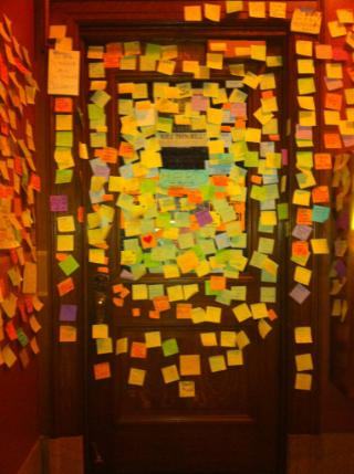 Representative Brett Husley's office door papered with post-its from unions, students and regular citizens thanking him for staying around the Capitol to oppose SB 11.