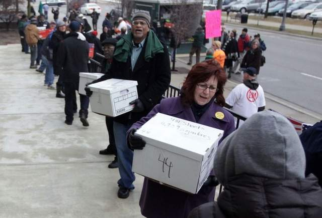 Over 200,000 signatures were delivered to repeal Public Act 4 (Source: Detroit Free Press)