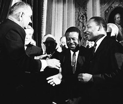Rev. Martin Luther King at the signing of the Voting Rights Act